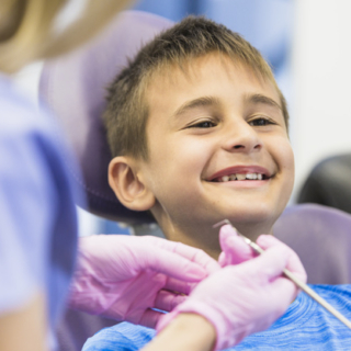 smiling-boy-going-through-dental-treatment-in-clinic